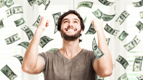 What would you do if you won the lottery? Portrait of a very happy young man in a rain of money; Shutterstock ID 148789697; PO: lottery-winner-money-stock-today-tease-160108; Client: TODAY Digital